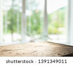 wood table top on blur of... | Shutterstock . vector #1391349011