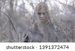 beautiful young woman behind... | Shutterstock . vector #1391372474