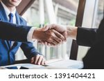 Small photo of Finishing up a meeting, handshake of two happy business people after contract agreement to become a partner, collaborative teamwork.