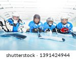 young hockey players laying on... | Shutterstock . vector #1391424944