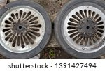 two old damaged metal wheels... | Shutterstock . vector #1391427494