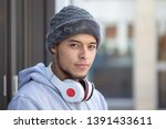 portrait of a young latin man... | Shutterstock . vector #1391433611