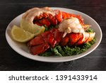 two broiled lobster tails on a... | Shutterstock . vector #1391433914