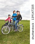 a cycling family in front of... | Shutterstock . vector #139147205
