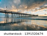 the pier at sunset  in imperial ... | Shutterstock . vector #1391520674