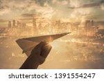 hand holding paper rocket...   Shutterstock . vector #1391554247