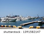 yacht parked in the seaport. | Shutterstock . vector #1391582147
