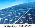 Solar Panels Against The Deep Blue Sky - stock photo
