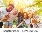 happy multicultural friends are ... | Shutterstock . vector #1391859257