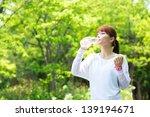 beautiful young woman drinking... | Shutterstock . vector #139194671
