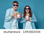 young couple watching movie in... | Shutterstock . vector #1392002534