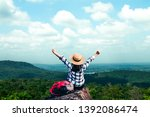 women tourists in the midst of... | Shutterstock . vector #1392086474