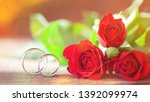 wedding rings and red roses on... | Shutterstock . vector #1392099974