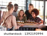 Waitress Serving Group Of...