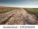 a long and stony path to the... | Shutterstock . vector #1392246344