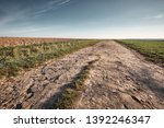 a long and stony path to the... | Shutterstock . vector #1392246347
