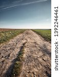 a long and stony path to the... | Shutterstock . vector #1392246461