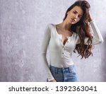 beautiful young woman in casual ... | Shutterstock . vector #1392363041