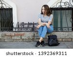 stylish young woman with... | Shutterstock . vector #1392369311