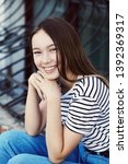 portrait of a stylish young... | Shutterstock . vector #1392369317