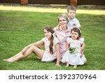 portrait of a happy family... | Shutterstock . vector #1392370964
