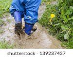 child in boots walking and... | Shutterstock . vector #139237427
