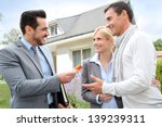 salesman giving home keys to... | Shutterstock . vector #139239311