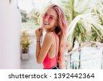 blissful caucasian girl in... | Shutterstock . vector #1392442364