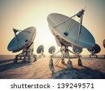 satellite dish array at sunrise. | Shutterstock . vector #139249571