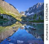 picturesque lake in the altai... | Shutterstock . vector #1392536294