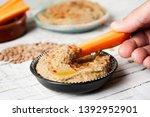 closeup of a man dipping a... | Shutterstock . vector #1392952901