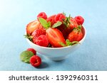bowl with strawberry and... | Shutterstock . vector #1392960311