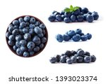 blueberries in a wooden bowl.... | Shutterstock . vector #1393023374