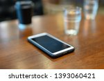 mobile phone placed on the wood ... | Shutterstock . vector #1393060421