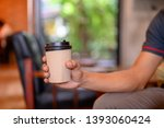 a cup of coffee ready to take... | Shutterstock . vector #1393060424