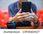 men check emails with mobile... | Shutterstock . vector #1393060427