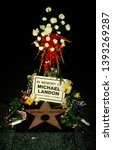 Small photo of LOS ANGELES - July 1, 1991: A floral memorial is placed on Michael Landon's star on the Hollywood Walk of Fame.