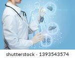 a medical worker adjusts a... | Shutterstock . vector #1393543574