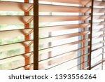 wooden shutters blind on the... | Shutterstock . vector #1393556264
