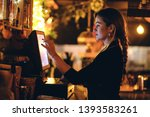 Stock photo small business people and service concept a young waitress at counter in a small bar or 1393583261