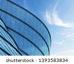 3D stimulate of high rise curve glass building and dark steel window system on blue sky background,Business concept of future architecture,lookup to the angle of the building. - stock photo