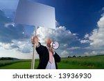 a man standing in a green field ...   Shutterstock . vector #13936930