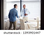 mature male patient shaking... | Shutterstock . vector #1393901447
