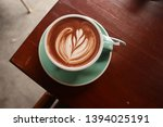 a cup of coffee with nice latte ... | Shutterstock . vector #1394025191