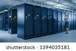 in data center  female it... | Shutterstock . vector #1394035181