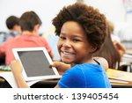 pupil in class using digital... | Shutterstock . vector #139405454