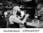 hipster brutal man drinking... | Shutterstock . vector #1394169257