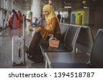 female muslim traveler looking... | Shutterstock . vector #1394518787