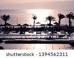 jordan  sunsetwith beach on red ... | Shutterstock . vector #1394562311