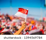 Waving A Singapore Flag During...